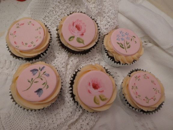 handpainted flowers on pink cupcakes for mother's day or female birthday.