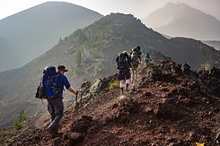 Group of People Hiking on Top of Mountain