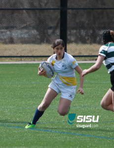 Anna Timmis making a break away against MSU during the 2019 Wolverine 7s A-Side