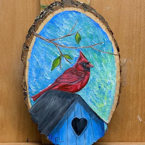 Cardinal on birdhouse