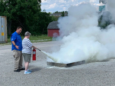 Learning how to use fire extinguisher