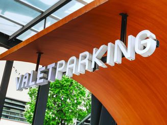 White Sign of Valet Parking Service at D