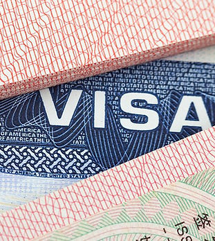 Representative photo of immigration documents. VISA, stamp in, stamp out.