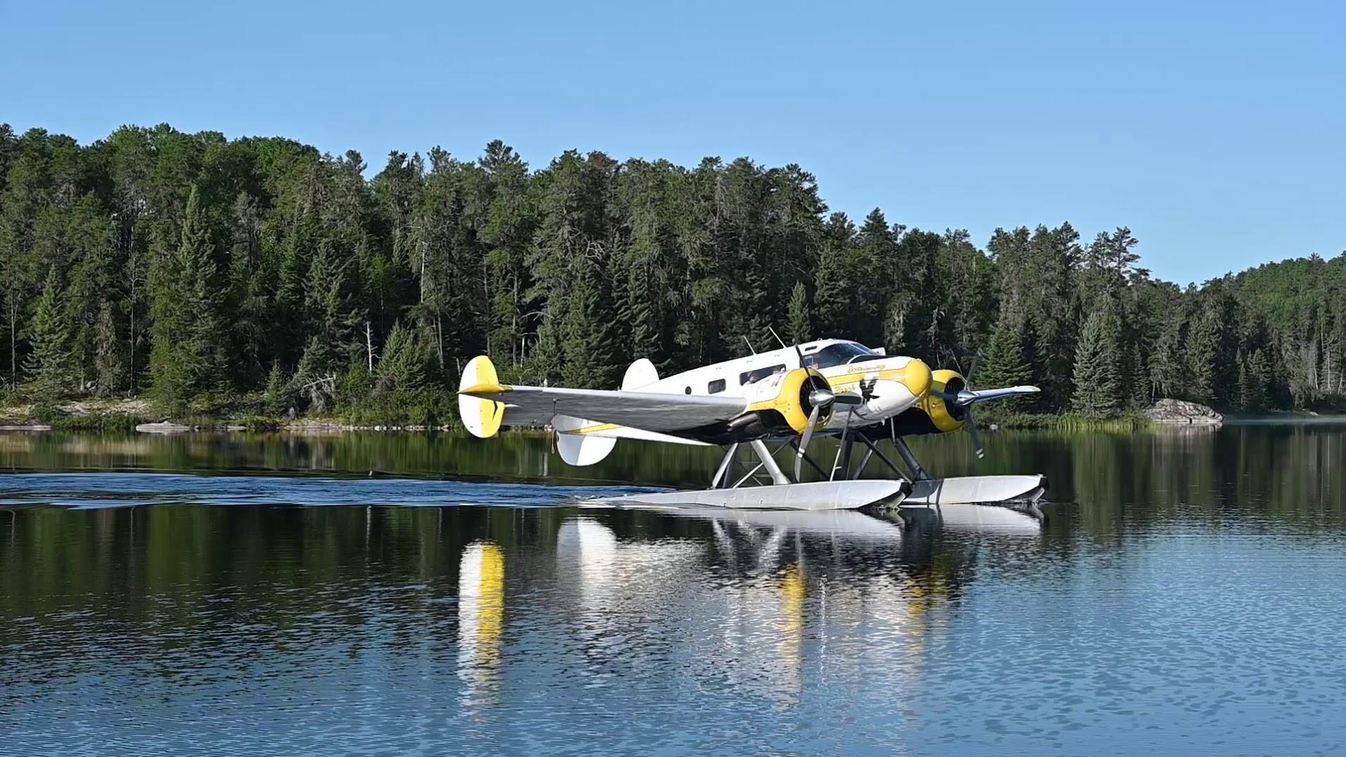 Beech 18 floatplane docking in Ontario.j