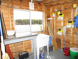 Fishtrap Lake outpost fish cleaning.JPG