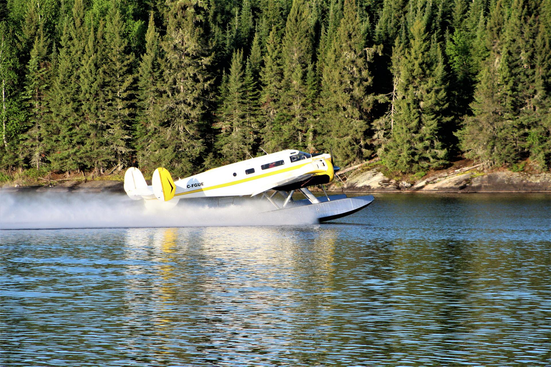 beech 18 floatplane taking off.jpg