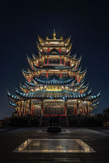 blue-yellow-and-green-lighted-pagoda-tow