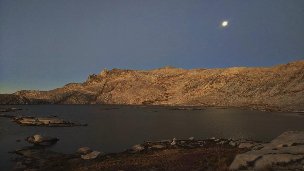 The moon setting over Moose Lake