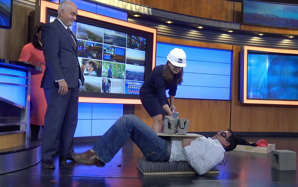 Craig Beals gets hit with a sledge hammer on the bed of nails on CBS Montana This Morning