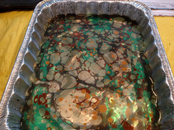 Stone pattern lays on top of water