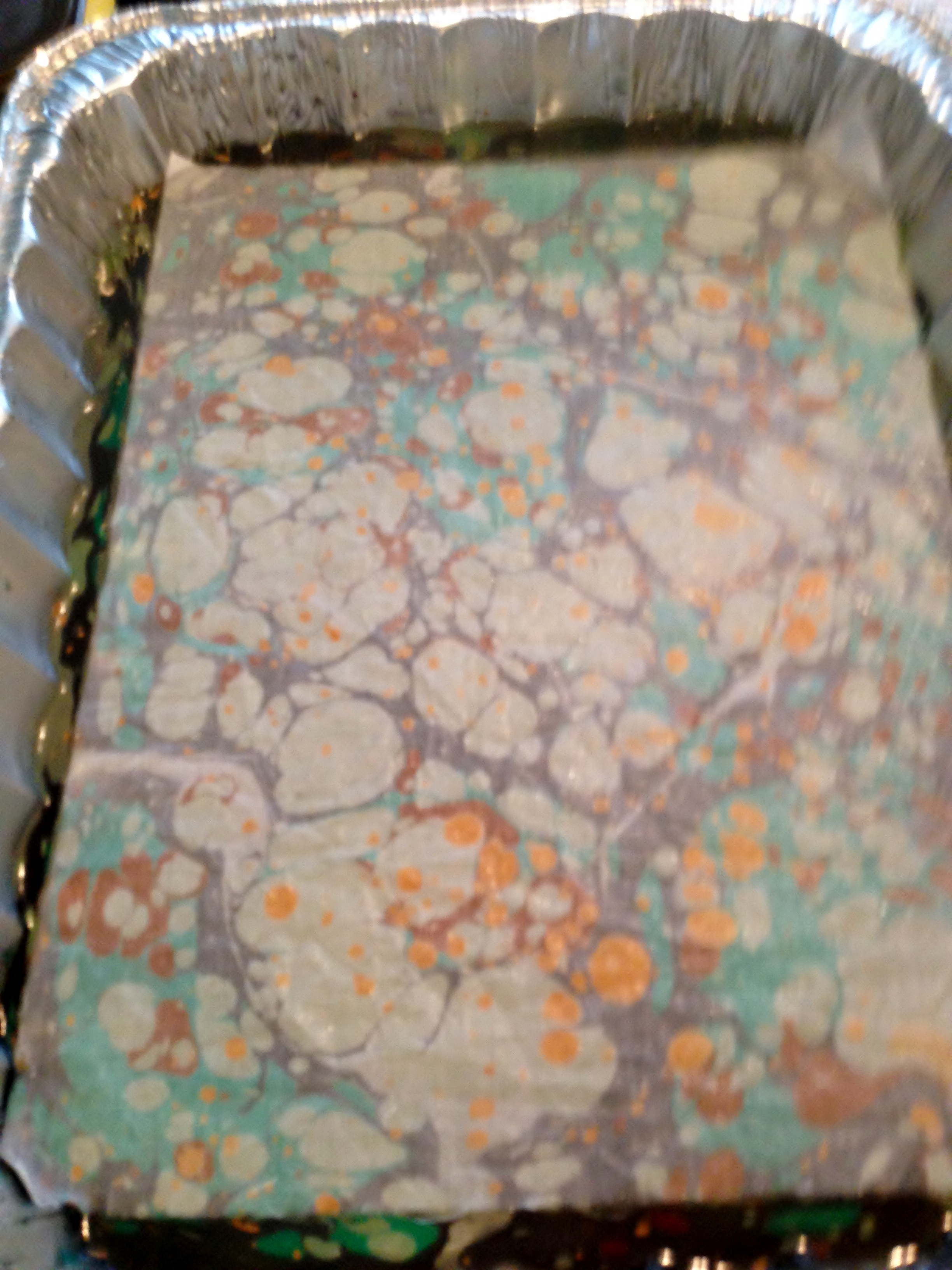 Fabric placed on top of paints