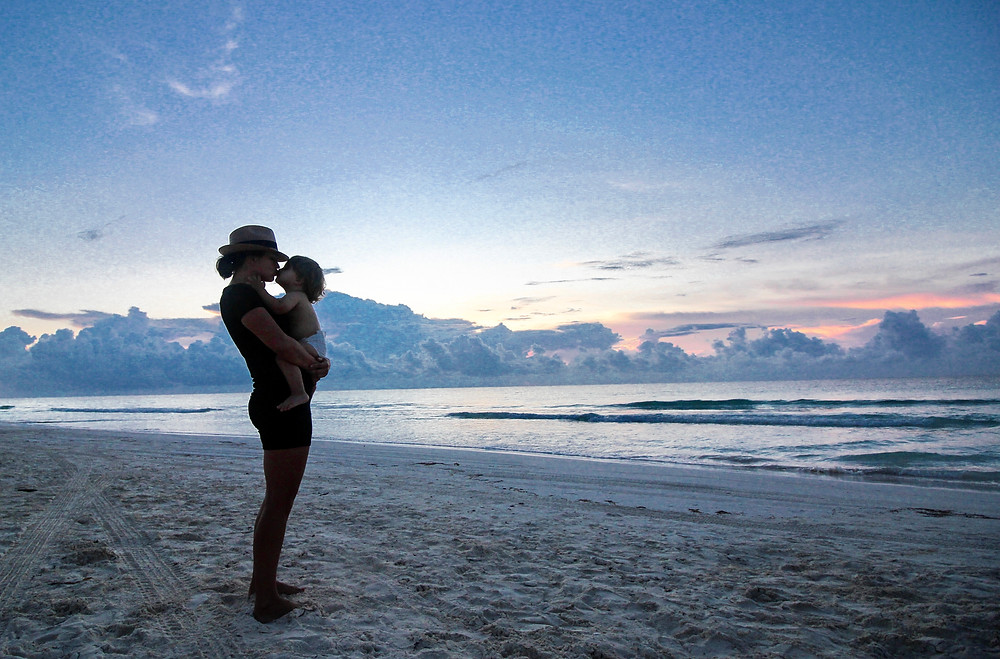 Watching the sunrise in Tulum with my baby