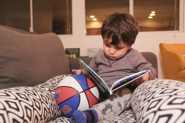 Reading to your toddler is a great activity during your first trimester.