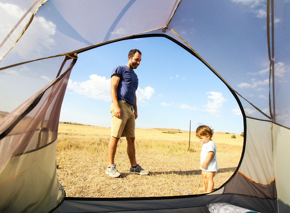 Jamie and Z hanging out at Sage Creek Campground in Badlands National Park. The view is from inside our tent.