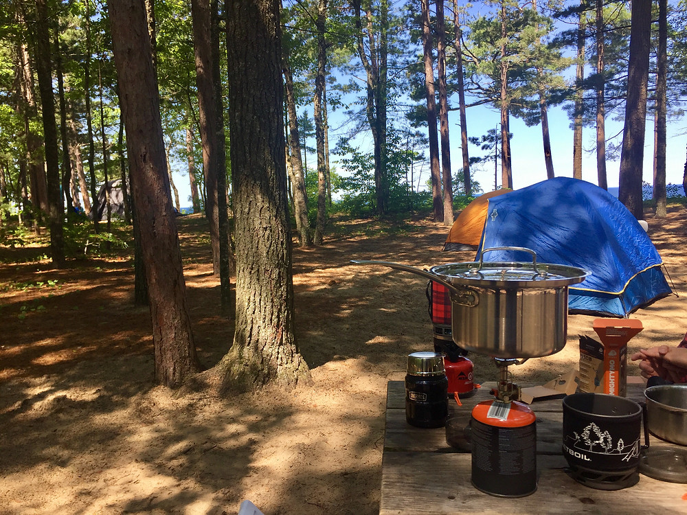 Our Jetboil and tents set up at Twelvemile Campground at Pictured Rocks State Park in Michigan