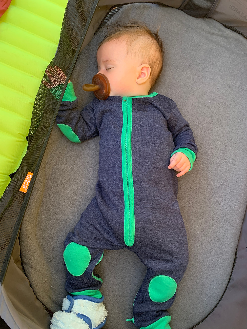 Sleeping infant all warm and cozy while camping
