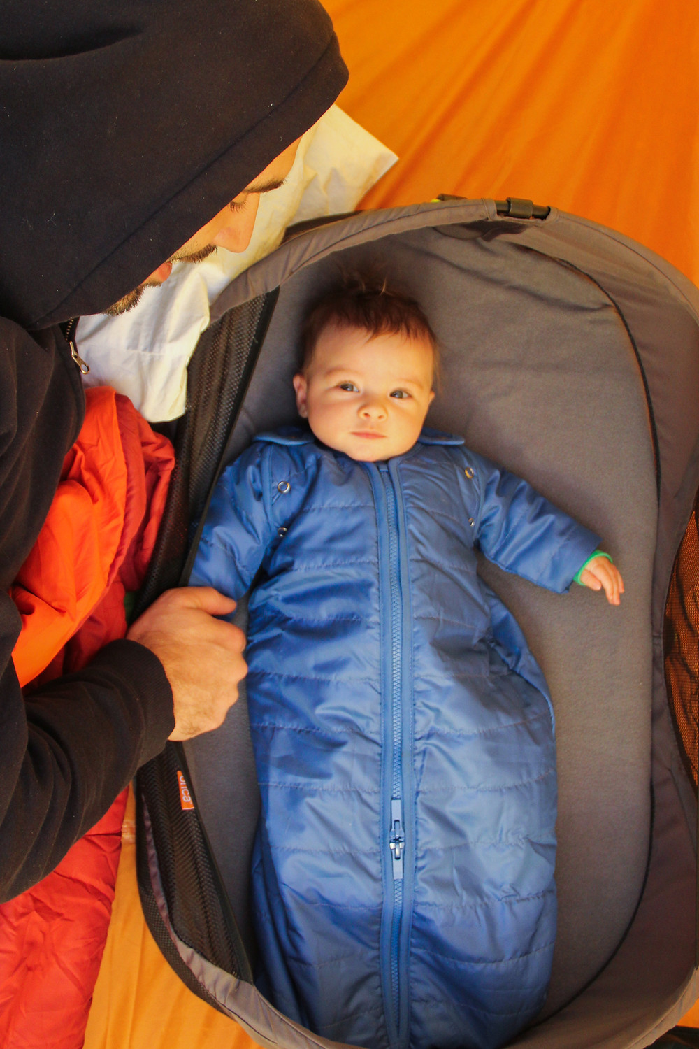 Our baby in a warm sleeping bag made for infants while camping