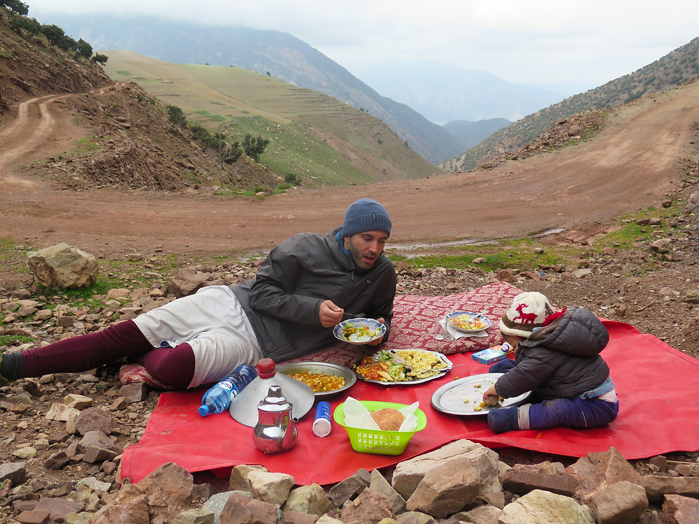 Eating a tagine outside of Imlil on a multi-day trek