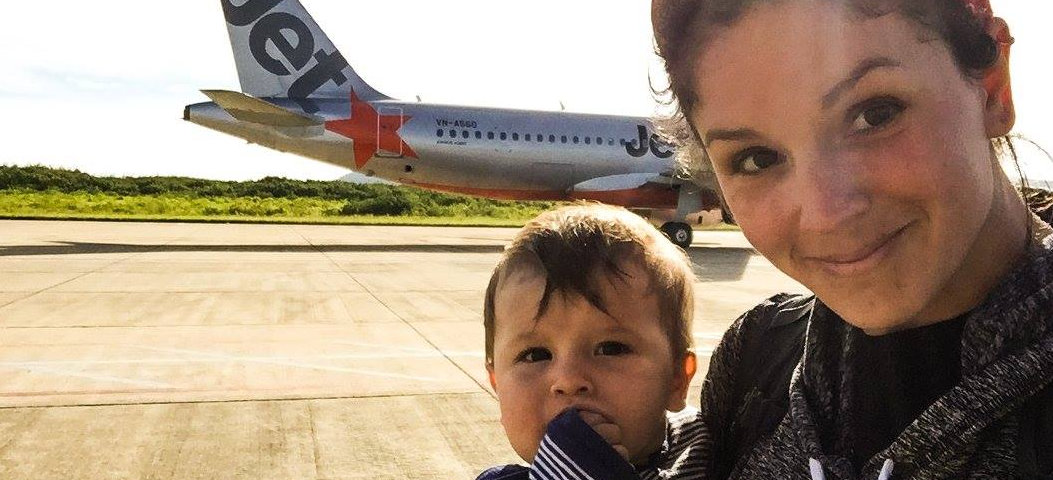 Mother and baby son boarding an airplane for our flight in Vietnam