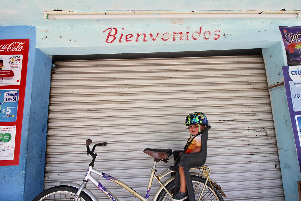 Baby on a bike in Tulum