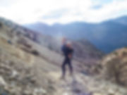 Mother hiking with baby son on her back using the Ergo 360