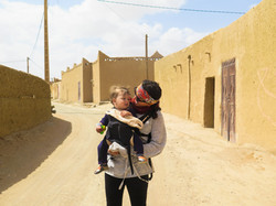 Me front-carrying our son in Morocco