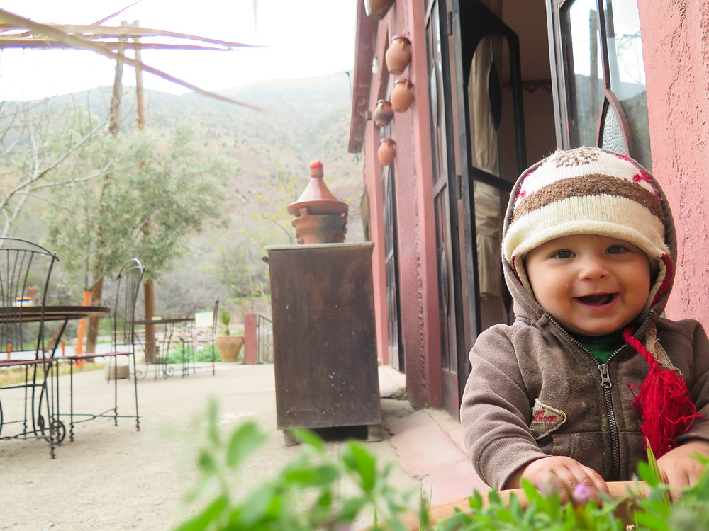 Baby Zay with a tagine in the back. Moroccan food was perfect for a baby to eat.