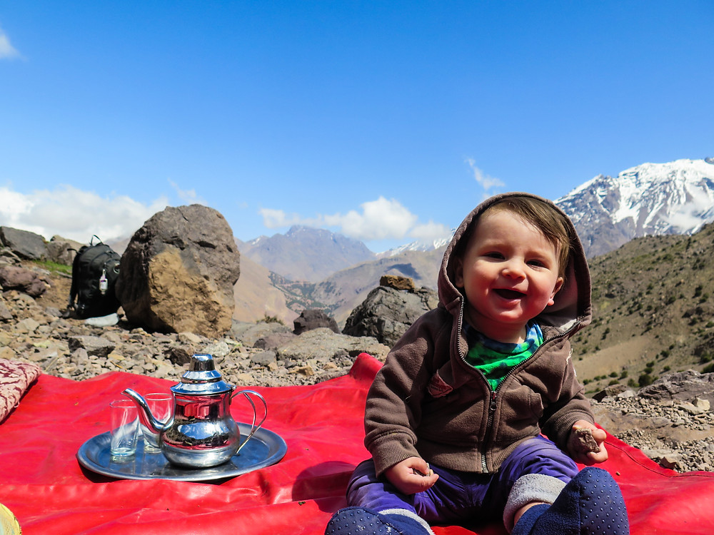 Our baby boy, Z, on the side of a mountain during a tea break. Snowy Mt. Toubkal is in the background, looking beautiful on a sunny, clear day.