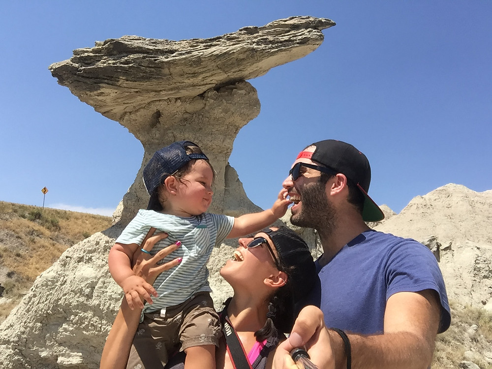 Our family taking a selfie in Badlands National Park in the heat of the day