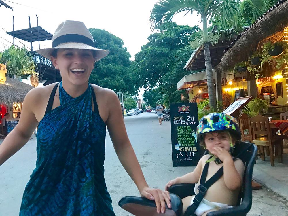 Bike break in downtown Tulum with Baby