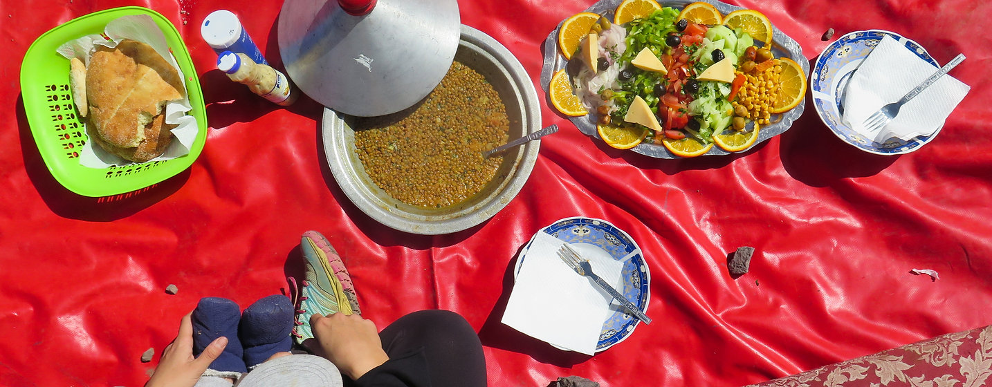 A meal mountainside in Morocco with our baby son. A tagine of lentils, bread, and a salad.