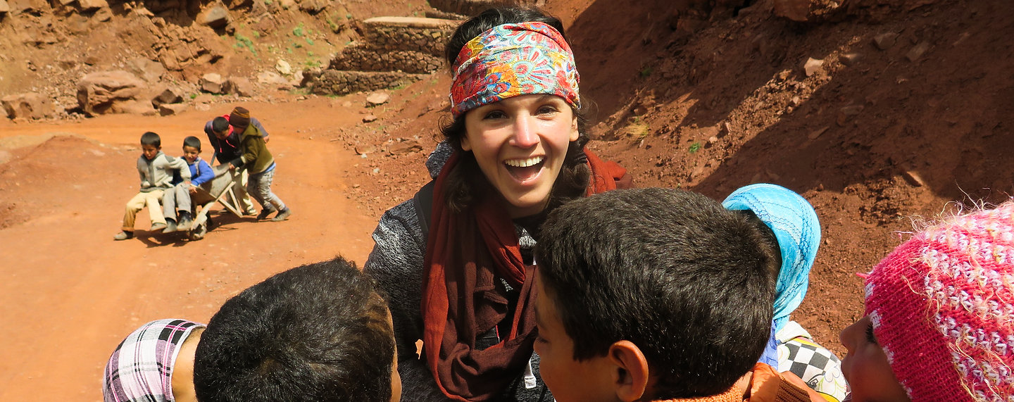 Me in Morocco showing photos to Berber children