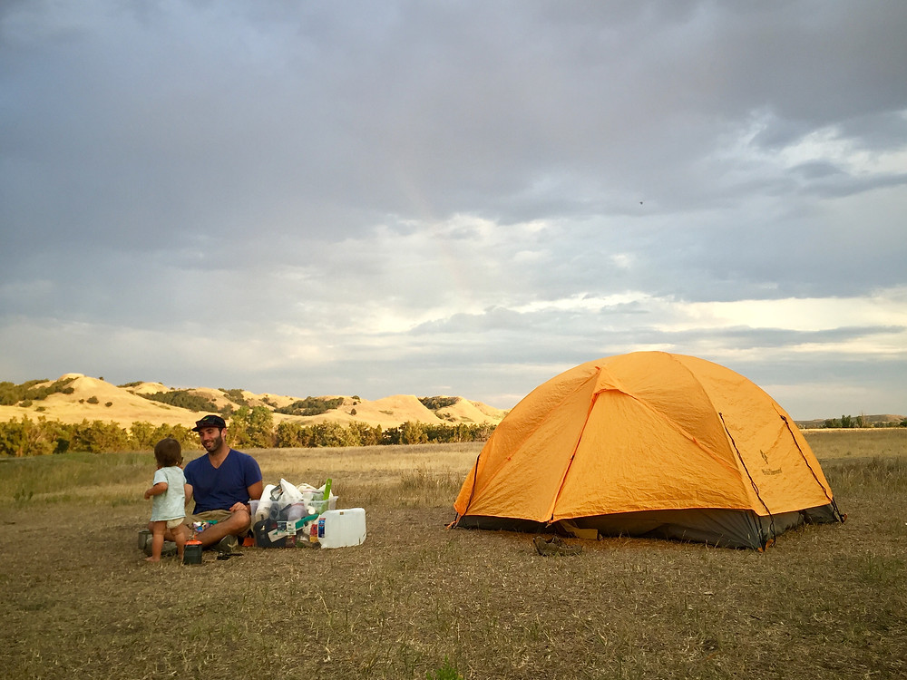Camping in Sage Creek Campground in Badlands National Park making dinner with our Jetboil