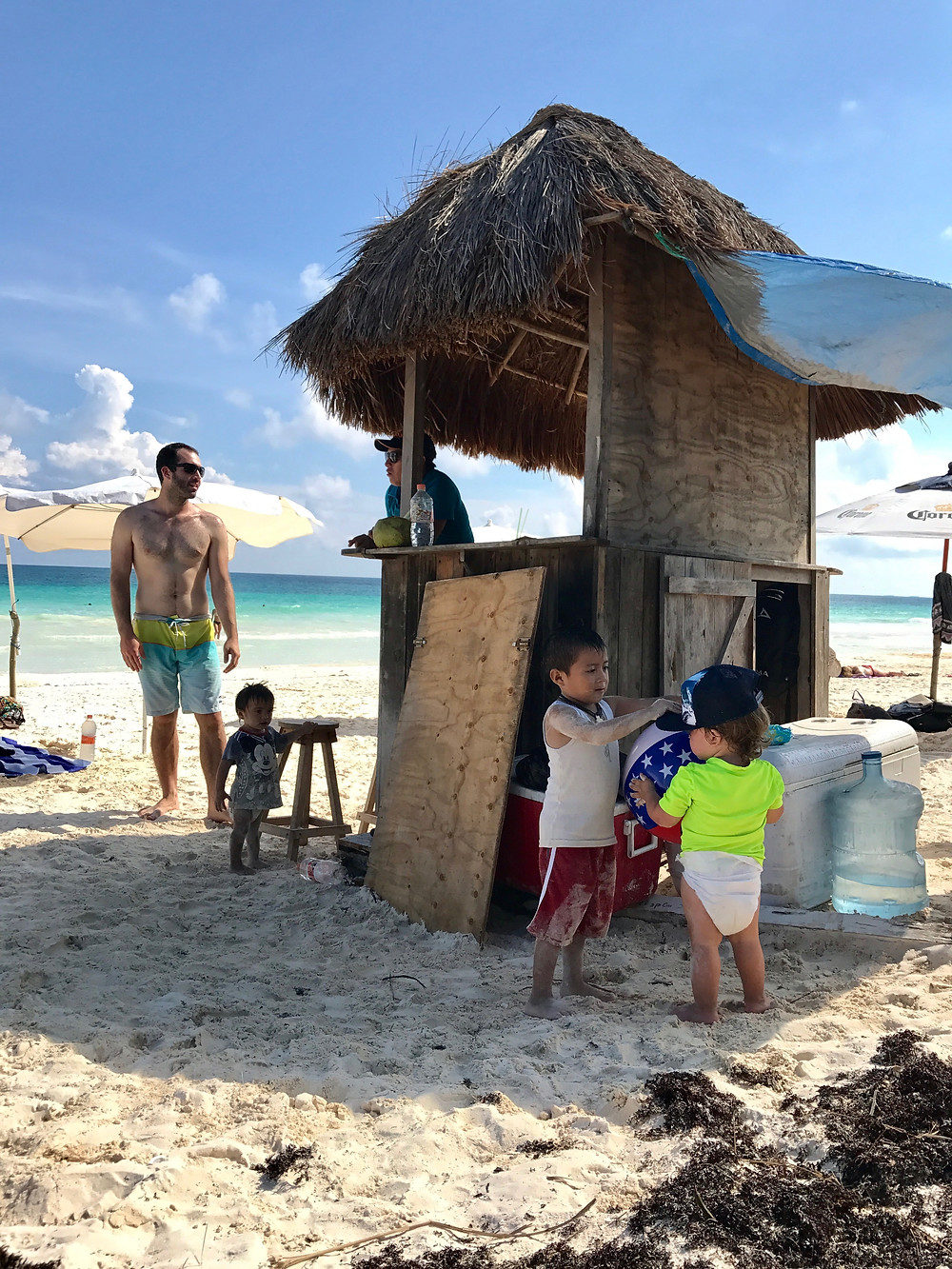 Babies on the beach in Tulum playing