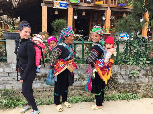 carrying a baby on my back with other mothers while traveling in Vietnam