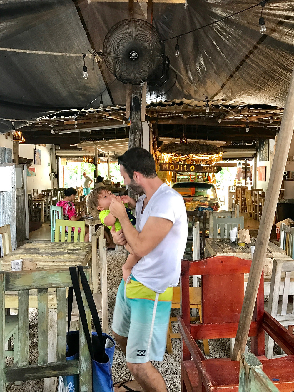 Relaxing at a coffee shop in Tulum with a baby