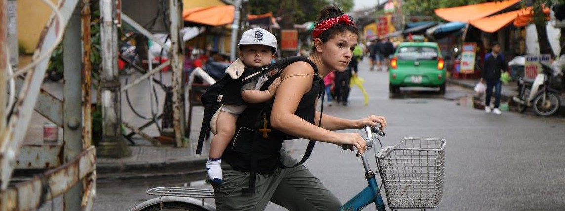 Biking with my baby on my back in the Ergo in Hoi An, Vietnam