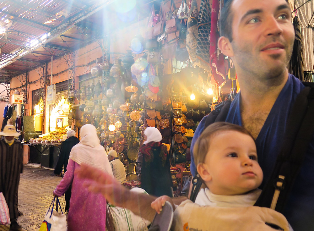 Baby and Dad walking around a medina in Morocco