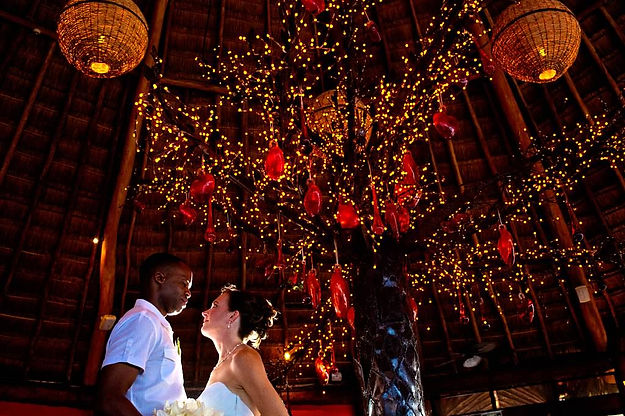 Lighting creates a dramatic statement at this destination wedding reception