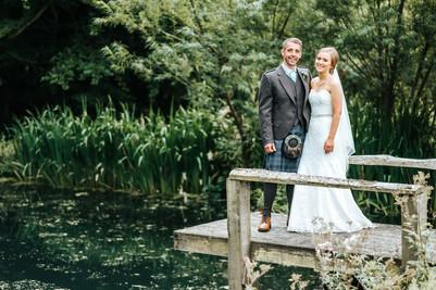 Bride & Groom next to a pond