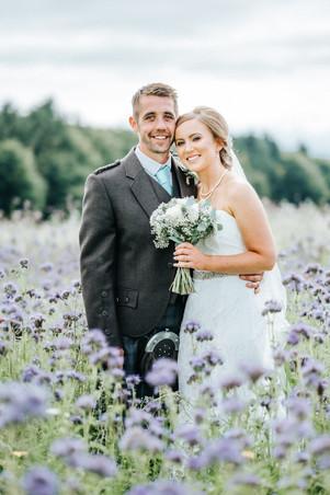 Bride & Groom in a field of wild flowers