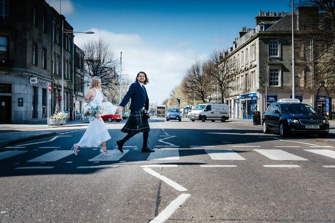 Bride & Groom walking across a pedestrian Crossing