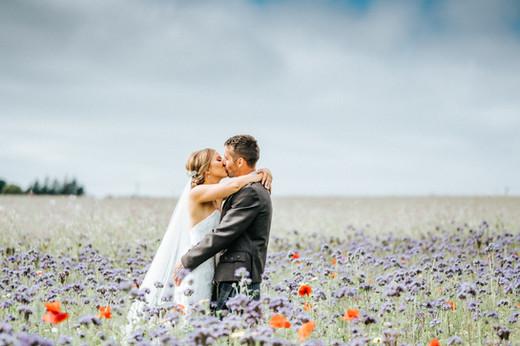 Bride & Groom in a wild flower field