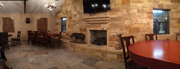 Decoration and fireplace in the lodge area, Thompson Hunting Lodge