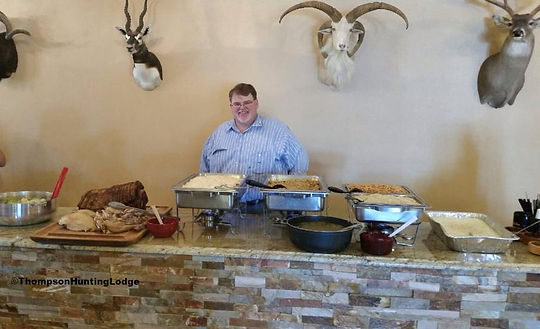 Tom benson catering the buffet line at Thompson Hunting lodge
