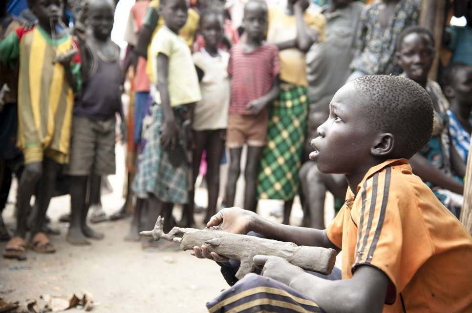 Young South Sudanese boy with mud gun