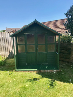 Re-roofing and painting shed