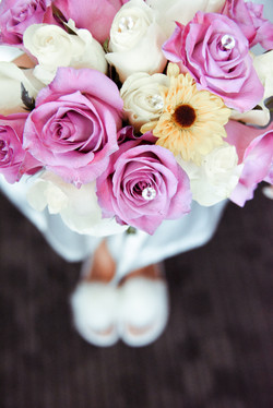 Bride Holding bouquet during getting ready ready photos