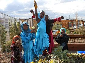 kids harvesting from garden.jpg