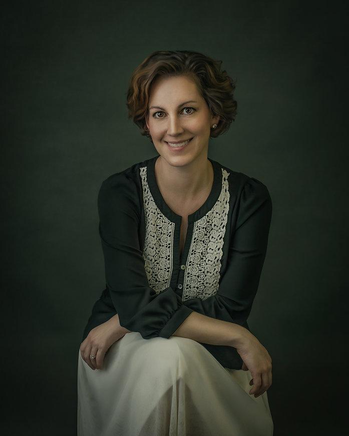 Huntsville photographer Krista Berg posing for a portrait.